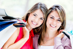 Beautiful female shoppers Stock Photo