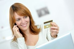 Beautiful female shopping online and paying with credit card Royalty Free Stock Image