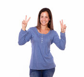Beautiful female showing victory sign with fingers Royalty Free Stock Images