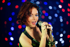 Beautiful female singer. On stage Royalty Free Stock Photo