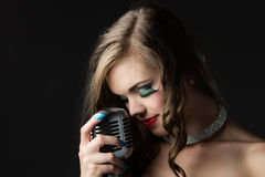 Beautiful female singer Stock Image