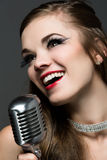 Beautiful female singer Stock Photography