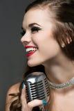 Beautiful female singer Stock Images