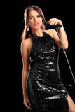 Beautiful female singer posing with microphone Stock Photo