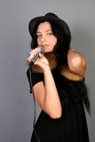Beautiful female singer singing a song Royalty Free Stock Photography