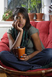 Beautiful female sitting with coffee Stock Image