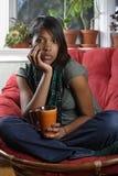 Beautiful female sitting with coffee Stock Image
