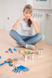 Beautiful female sitting on wooden floor Stock Photography