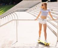 Beautiful female skater looking away Royalty Free Stock Photo