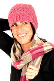 Beautiful female smiling big wearing pint knit hat Stock Image