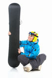 Beautiful female snowboarder sitting with snowboard in hands Royalty Free Stock Photos