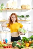 beautiful female stand holding cabbage in hands, lead heathy lifestyle and eating