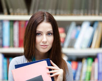 Beautiful female student with books Royalty Free Stock Images