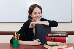 Beautiful female student with books. Smiling at the camera Stock Photography