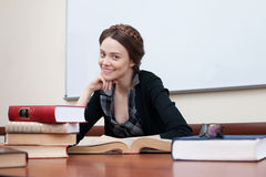 Beautiful female student with books. Smiling at the camera Stock Images