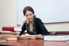 Beautiful female student with books. Smiling at the camera Royalty Free Stock Photography