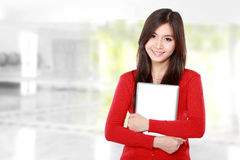 Beautiful female student with books smiling Stock Image