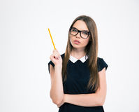 Beautiful female student in glasses holding pencil Stock Photography