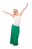 Beautiful female student in a green skirt with hands raised Royalty Free Stock Photos