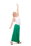 Beautiful female student in a green skirt with hands raised. Stock Images