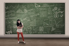 Beautiful female student and hand drawn chalkboard Royalty Free Stock Photo
