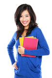 Beautiful female student holding notebooks Royalty Free Stock Photography