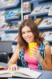 Beautiful female student in a library Stock Photography