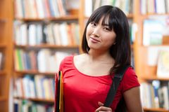 Beautiful female student in a library. Beautiful female student in a university library Stock Images
