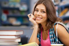Beautiful female student in a library Stock Image