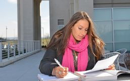 Beautiful female student outside of building Stock Image