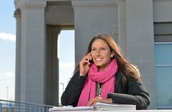 Beautiful female student outside of building Stock Photo