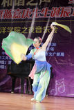 Beautiful female student perform folding fan dance Stock Photography
