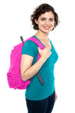 Beautiful female student with pink backpack Royalty Free Stock Image