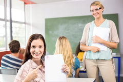 Beautiful female student pointing at paper Royalty Free Stock Image