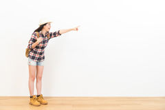 Beautiful female student pointing to copyspace. Beautiful female student pointing to the background of the blank copyspace choose the destination of personal Royalty Free Stock Photography