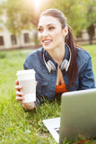 Beautiful female student is resting in campus Stock Photos