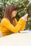 Beautiful female student text messaging Stock Images