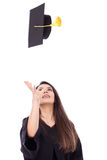 Beautiful female student throws up his graduation cap in celebra Royalty Free Stock Photography