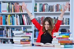 Beautiful female student in a university library. Group of students learning in library at university stock images