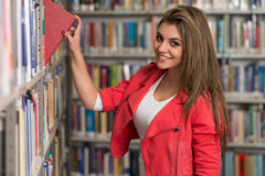 Beautiful Female Student In A University Library Stock Photography