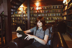 Beautiful female student in a university library Royalty Free Stock Photos
