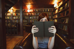 Beautiful female student in a university library Stock Images