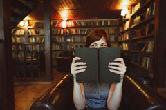 Beautiful female student in a university library Royalty Free Stock Photography