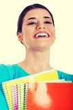 Beautiful female student with workbook. Stock Photography