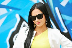 Beautiful female in sunglasses. Closeup of beautiful female in sunglasses royalty free stock images