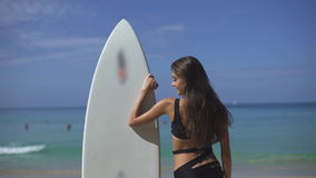Beautiful Female Surfer Looking For The Waves stock footage