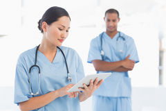 Beautiful female surgeon holding digital tablet Stock Photography