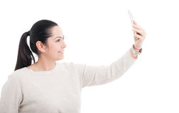 Beautiful female taking a  self portrait with cellphone Stock Images