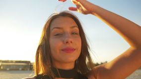 Beautiful female taking selfie on a beach stock footage