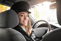 Beautiful female taxi driver Royalty Free Stock Photos